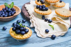 Closed berry tartlets baskets Cake with berries Stock Photography