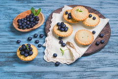 Closed berry tartlets baskets Cake with berries Stock Photos