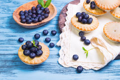 Closed berry tartlets baskets Cake with berries Royalty Free Stock Photos