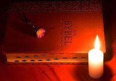 Closed Bible by candle light Royalty Free Stock Photography