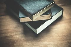 Closed Bibles on the wood background. royalty free stock photo