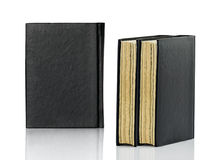 Closed black book is laying on white background Royalty Free Stock Photo