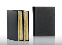 Closed black book is laying on white background Royalty Free Stock Images