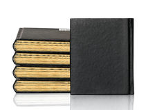 Closed black book is laying on white background Royalty Free Stock Image