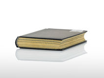 Closed black book with shadow on white background Royalty Free Stock Image