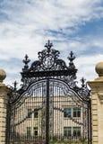 Black Wrought Iron Gate on Mansion Royalty Free Stock Image