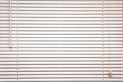 Closed blinds. Background image of off white mini blinds inside home closed Royalty Free Stock Photography