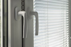 Closed blinds and window handles Royalty Free Stock Photo