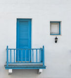 Closed blue door and window on two floor Stock Photo