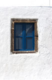Closed blue window in a greek house Stock Images
