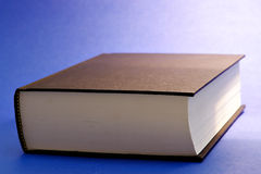 Closed book. Book on blue background Royalty Free Stock Photos