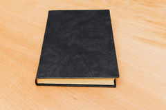 Closed book with empty black cover Stock Photo