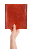 Closed book in hand Stock Images