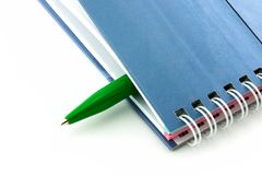 Closed book and pen Royalty Free Stock Photos