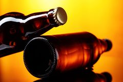 Free Closed Bottles Of Beer On A Brown Background. Stock Photos - 109620533