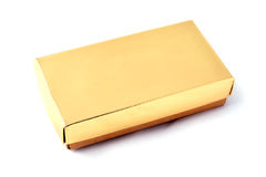Closed box. Closed golden giftbox, white background and clipping path Royalty Free Stock Image