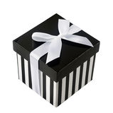 Closed box with black and white stripes. And white ribbon isolated on white background Stock Photos