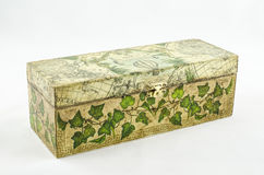 Closed box with handmade floral motif. Stock Photo