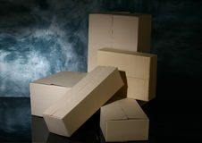 Closed boxes. On dark background Stock Photo