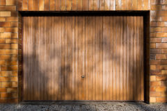 Closed brown garage door. With brown tiled wall royalty free stock photography