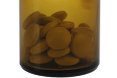 Closed brown jar with pills. Royalty Free Stock Images