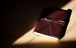 Closed brown leather diary with flap and lacing Royalty Free Stock Photos