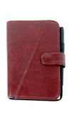 A closed brown leather notebook Stock Images
