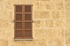 Closed brown wood window Stock Images