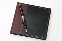 Closed business leather agenda with golden pen Stock Images