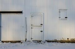 A metal farm building door in Iowa. A metal/steel barn door in Ottosen, Iowa royalty free stock photo