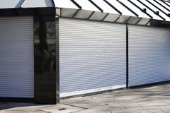 Free Closed Business Shop Or Store Front With Roller Shutters Stock Photo - 176923150