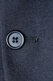 A closed button on a suit jacket Royalty Free Stock Images