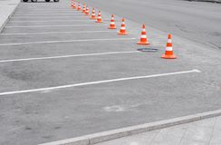Closed car parking lot with white mark and traffic cone on street used warning sign on road. Closed car parking lot with white mark, traffic cone on street used Stock Images