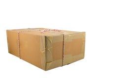 Closed cardboard box taped up Royalty Free Stock Photos