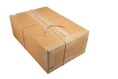 Closed cardboard box taped up and isolated royalty free stock photography