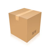 Closed cardboard box taped up. And isolated on a white background Royalty Free Stock Images