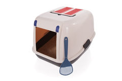 Closed cat litter box with scoop stock photography