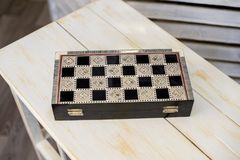 Closed chessboard for chess game on wooden table royalty free stock photos
