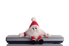 Closed for christmas. Santa claus closed the pc and goes christmas. White background stock photography