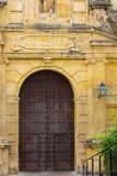 Church gate and yellow walls. Closed church gate and yellow walls Royalty Free Stock Image