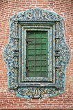 Closed church window with glased ornate tile Royalty Free Stock Photography