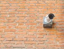 Closed circuit camera on brick wall. One closed circuit camera on brick wall stock photography