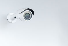 Closed circuit camera; CCTV on white background. With copy space royalty free stock image