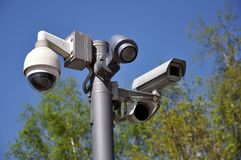 Closed circuit camera Multi-angle CCTV system against the blue sky. Installed on a city street stock photography