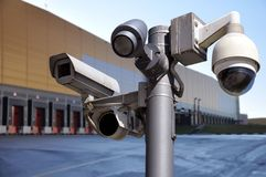 Closed circuit camera Multi-angle CCTV system on the background of the warehouse buildings royalty free stock photos