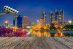 Closed Circuit Television camera monitoring of Benchakitti Park. At night sky in Bangkok, Thailand stock images