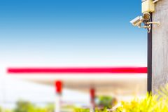 Closed Circuit Television camera monitoring gas station blurry background. Security cameras at a gas station royalty free stock photo