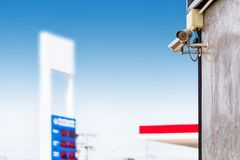 Closed Circuit Television camera monitoring gas station blurry background. Security cameras at a gas station royalty free stock photos