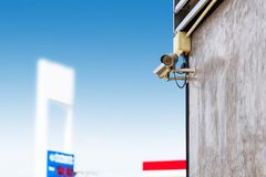 Closed Circuit Television camera monitoring gas station blurry background. Security cameras at a gas station stock photos