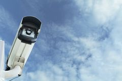 Closed Circuit Television camera. Closed circuit television recording on sky background. stock photo